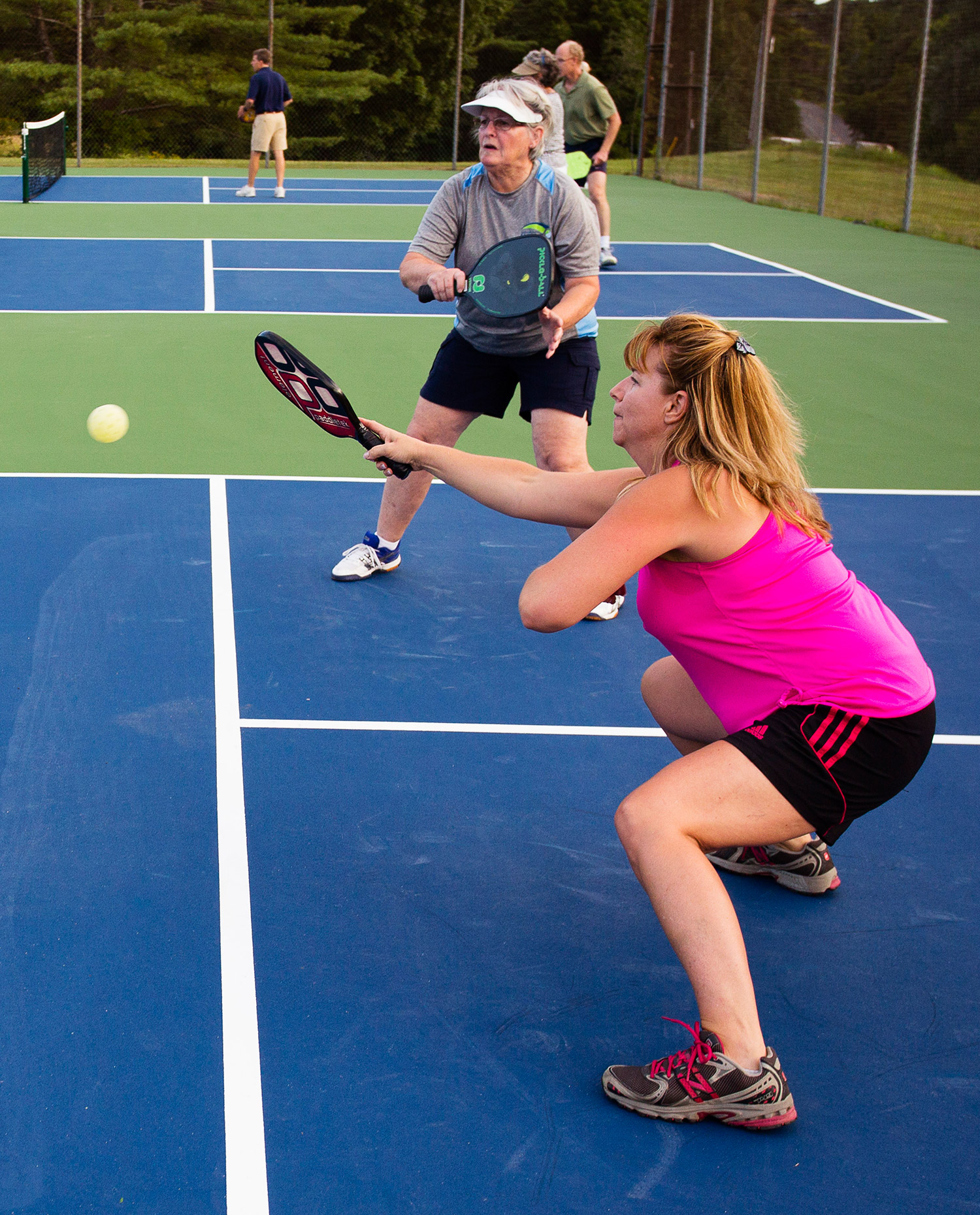 Sue Ann Smith of Gorham returns a volley during pickleball matches in Gorham. Carl D. Walsh/Staff Photographer