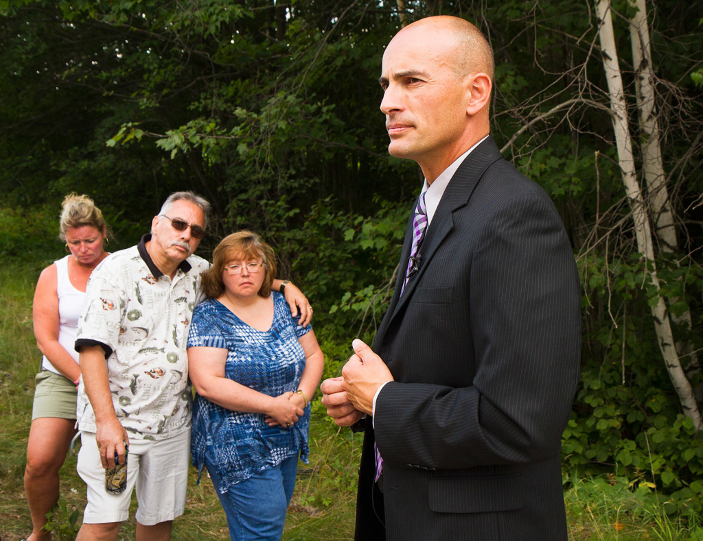 Ron Moreau and Karen Dalot, uncle and sister of Kimberly Moreau, listen to Maine State Police Detective Sgt. Mark Holmquist give an update on the search for Kimberly Moreau near Route 108 in Canton on Sunday.