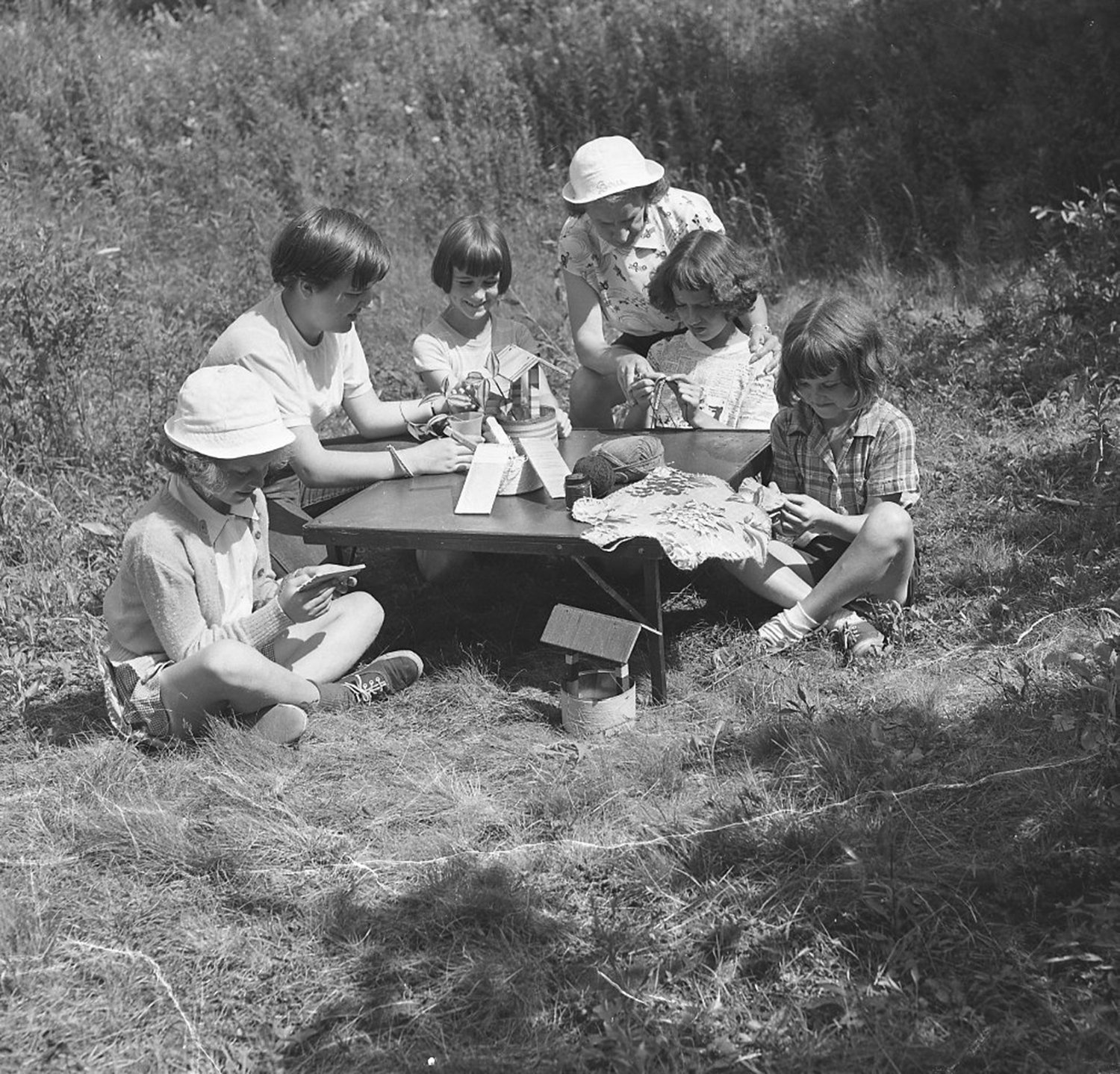 Girl Scouts (Brownies) collecting leaves, July 26, 1951. From the Portland Public Library archival collection of Portland Press Herald, Maine Sunday Telegram and Evening Express photos.