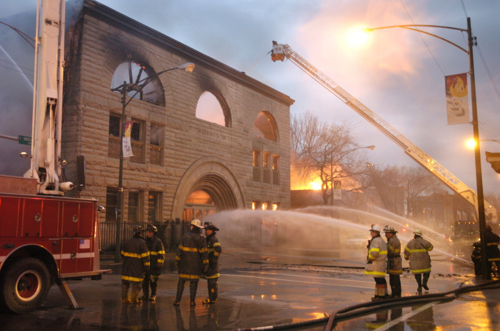 Chicago firefighters battle a major fire at Pilgrim Baptist Church, a treasured landmark designed by Louis Sullivan, in 2006. Plans to restore the church have stalled for nearly 10 years, fueling frustation in the community.