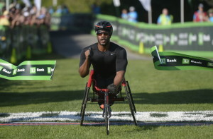 James Senbeta of Champaign, Illinois, is the first in the wheelchair category to cross the finish line of Saturday's TD Beach to Beacon 10K.