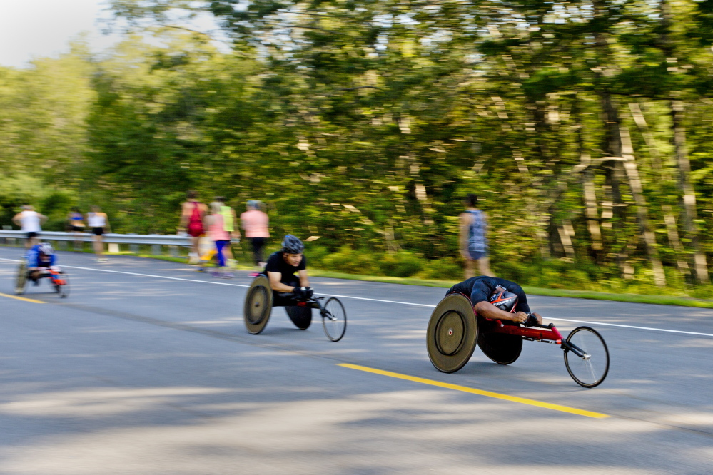 The wheelchair athletes race down the course at the Beach to Beacon 10K on Saturday in Cape Elizabeth.
