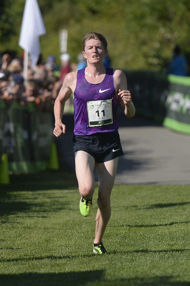 Eric Jenkins is the first American to cross the finish line of the TD Beach to Beacon 10K on saturday.