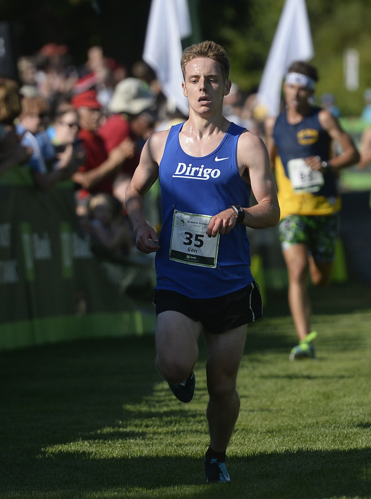 Ben Decker of Yarmouth is the first from Maine to cross the finish line of the TD Beach to Beacon 10K on Saturday.