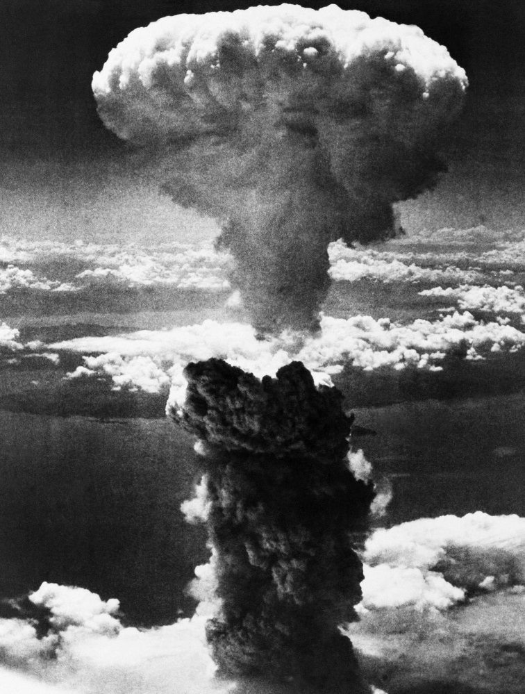 A mushroom cloud rises after the atomic bomb was dropped on Nagasaki, Japan, on Aug. 9, 1945, immediately killing 73,000.