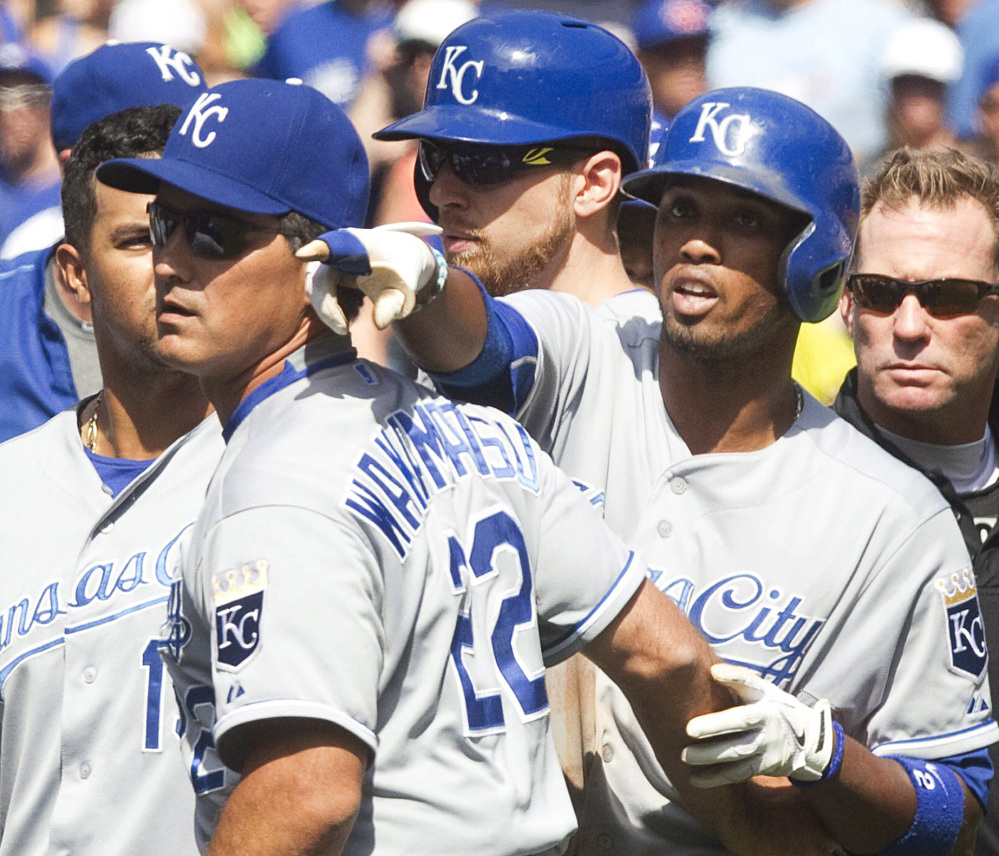 Kansas City's Alcides Escobar, right, is held back during a scuffle that broke out in the eighth inning of the Blue Jays' 5-2 win at Toronto on Sunday.