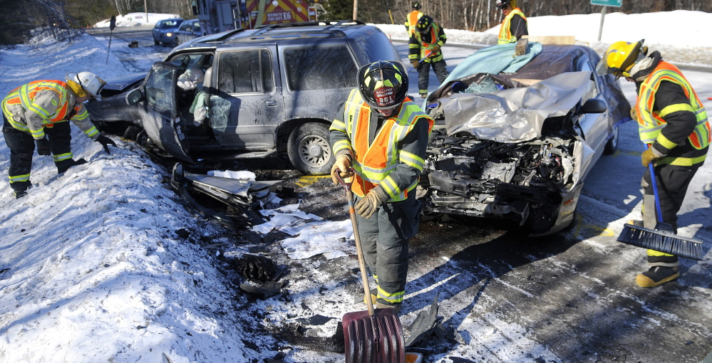 Monmouth firefighters collect debris from a two-car collision that killed Joan L. Fortier, 67, of Mount Vernon last year on U.S. Route 202 in Monmouth.