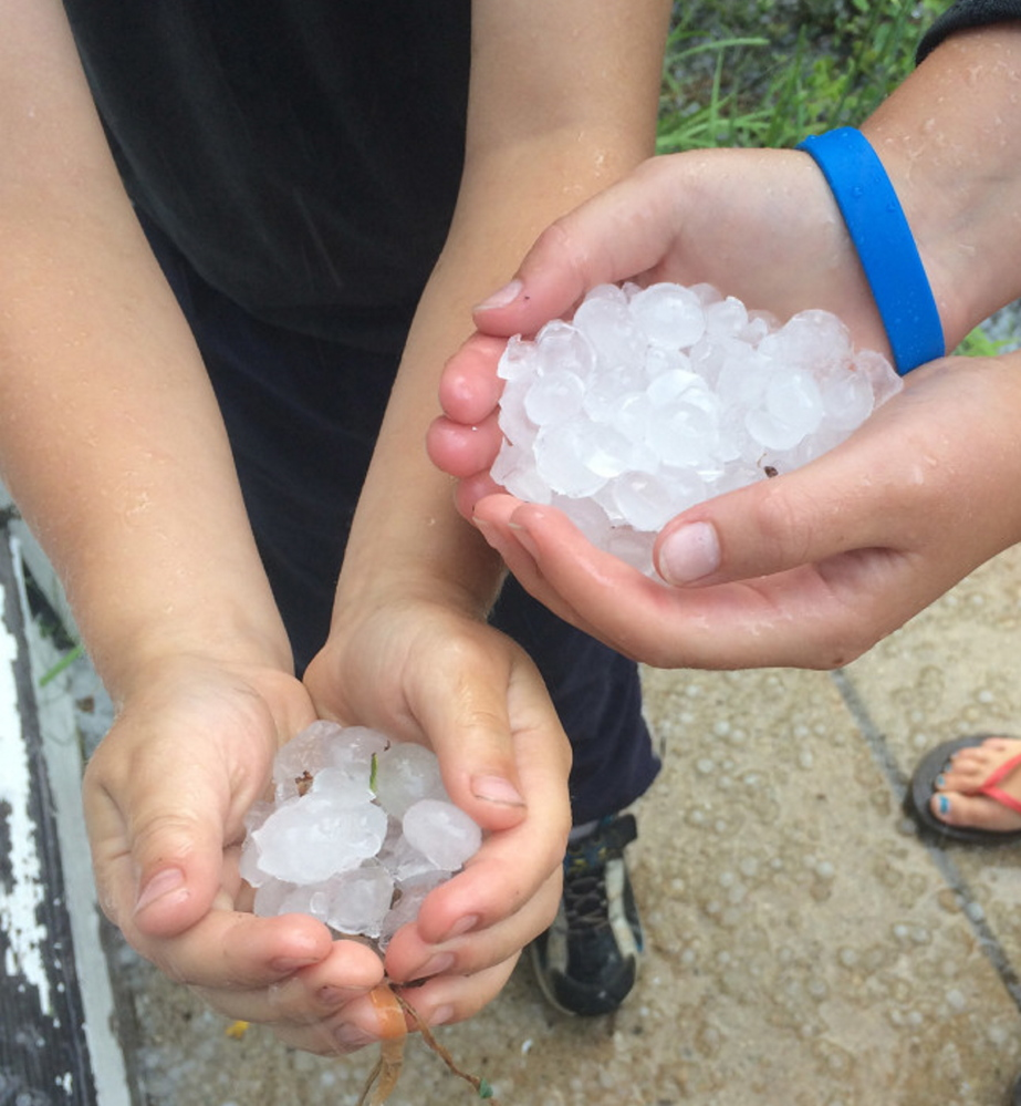 Kate and Dan Gallagher show some of the hail they collected from Tuesday's storm in Portland.