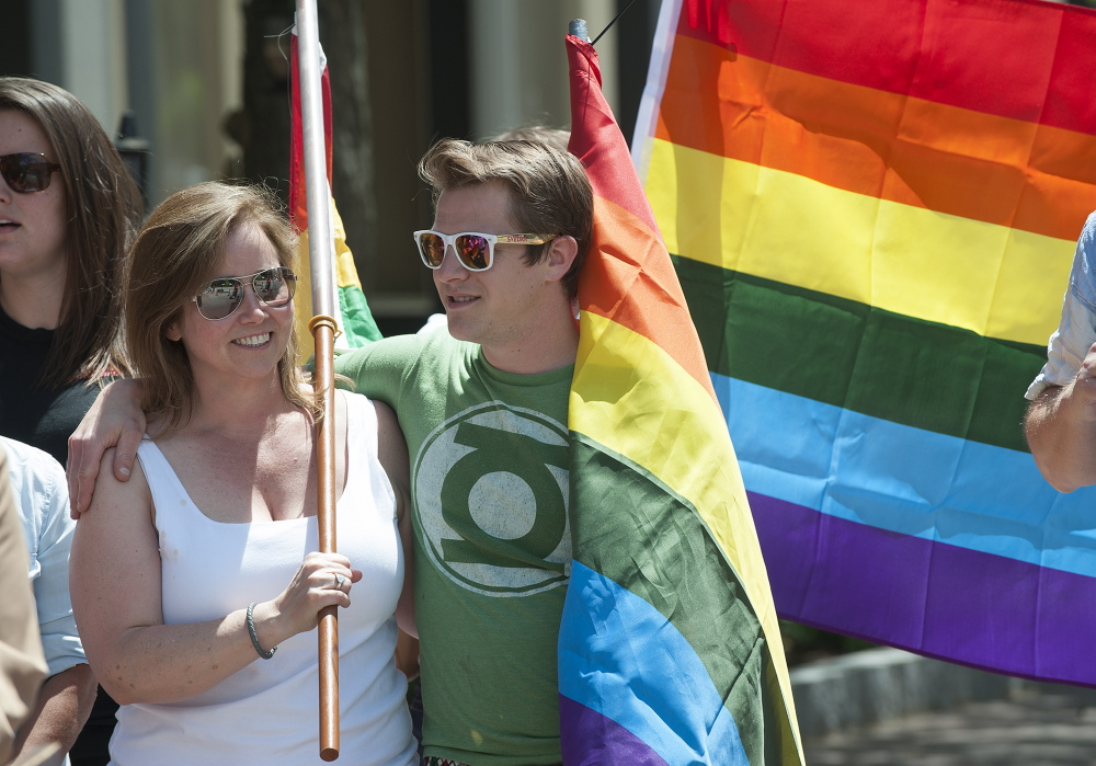 Cindy Connor Self and Zach Robbins, both of Bangor, embrace during a June 26 rally in Bangor celebrating the U.S. Supreme Court's ruling legalizing gay marriage in all 50 states. Since 2009, opponents of same-sex marriage have been fighting to shield the identities of those who have donated money to their efforts in Maine.