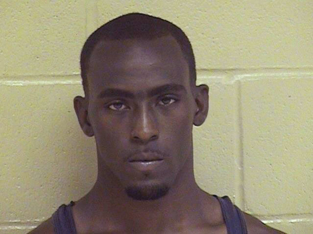This undated booking photo released by the Shreveport Police Department shows Grover Cannon, named as a suspect in the shooting death of Shreveport police officer Thomas LaValley.