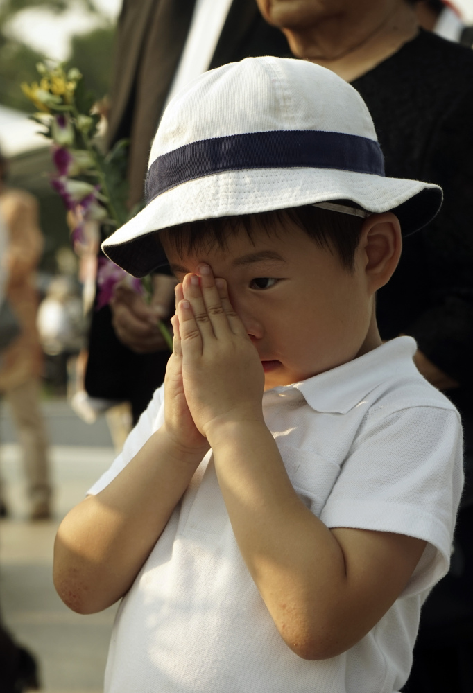 A boy in Memorial Park in Hiroshima prays Thursday for the victims of the atomic bombing of that city.