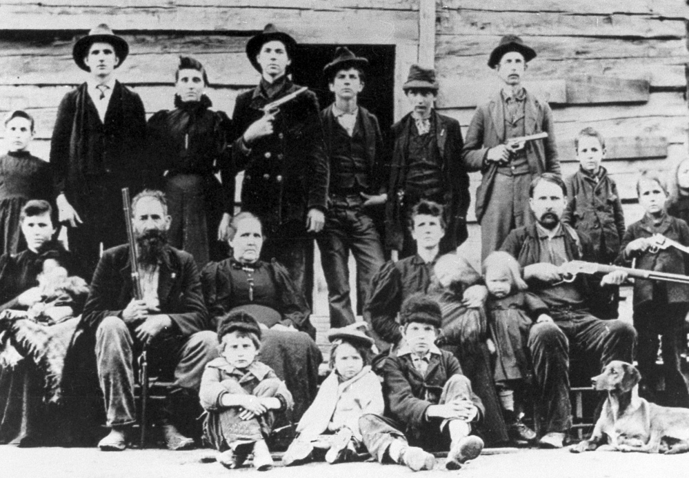 The  Hatfield clan poses in April 1897 at a logging camp in southern West Virginia.  The most infamous feud in American folklore, the long-running battle between the Hatfields and McCoys,