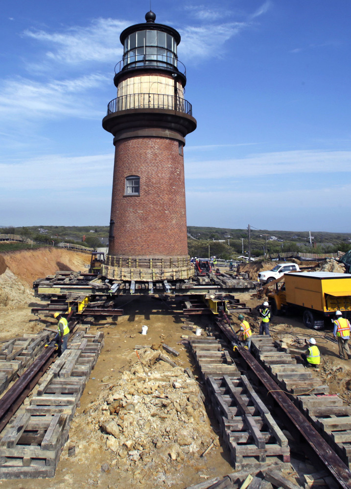 Workers move Gay Head Light along rails May 28 in Aquinnah, Mass., on Martha's Vineyard. It's light will shine again Tuesday.