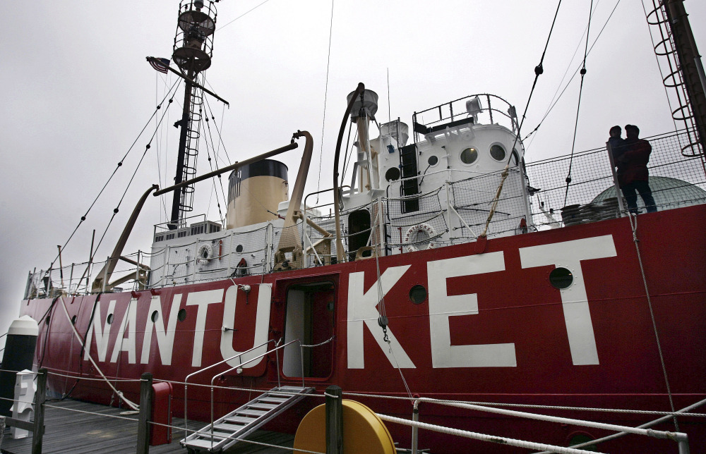 The Nantucket Lightship sits anchored at Rowes Wharf in Boston. Its powerful beacon was lit for about two minutes for the first time in 40 years Friday and then powered down again. The lightship operates as a museum.
