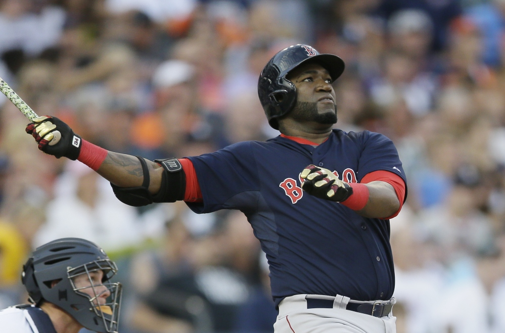 David Ortiz follows through on his two-run home run off Detroit Tigers starting pitcher Daniel Norris on Friday night. The home run, Ortiz's 22nd of the season, gave Boston a 4-0 lead.