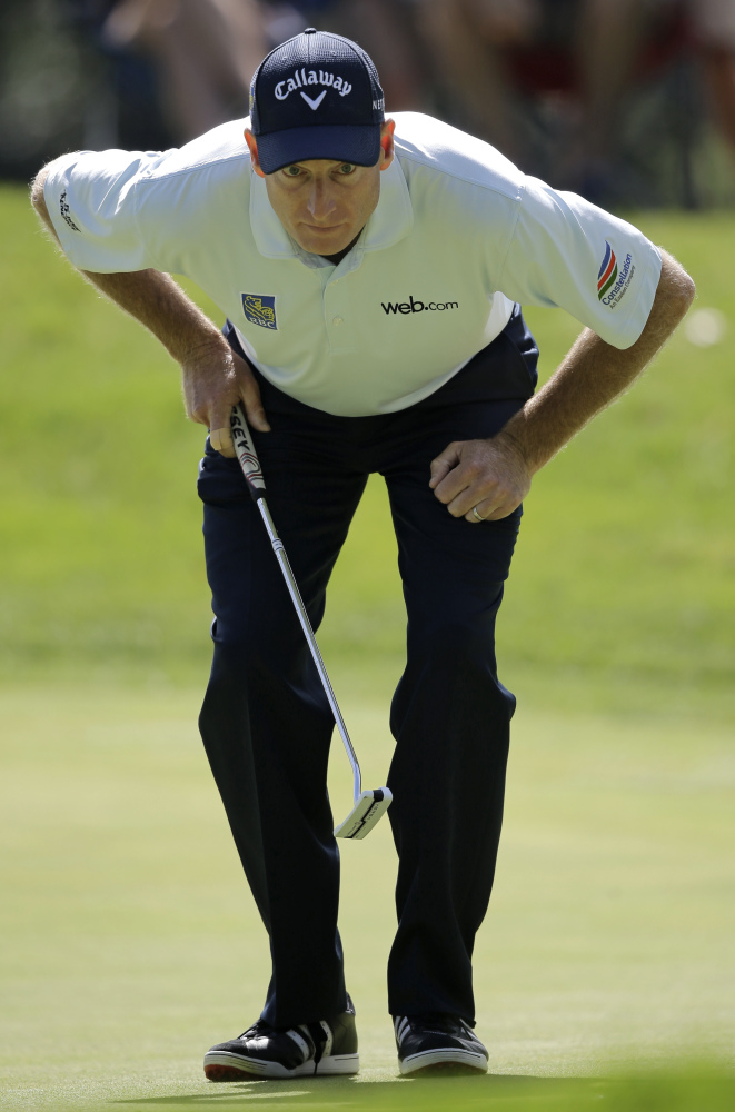 Jim Furyk lines up a putt on the 11th hole during the second round of the Bridgestone Invitational golf tournament Friday at Firestone Country Club in Akron, Ohio. Furyk shot a 4-under 66 for the second straight day and leads by four strokes at the midway point of the tournament.