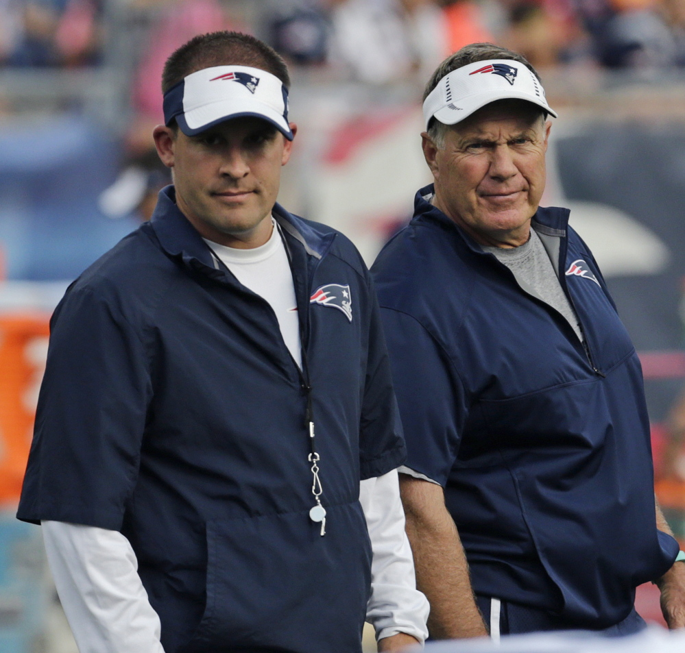 New England Patriots Coach Bill Belichick, right, and offensive coordinator Josh McDaniels watch practice Wednesday at the team's training camp. The Patriots have 24 injured players, partially because of their shortened offseason.