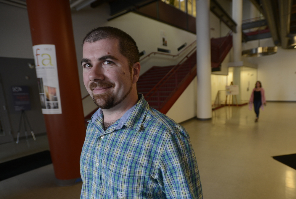 Todd Richard stands in the lobby of the Maine College of Art in Portland, which he will attend this fall. The tuition is daunting: He's still paying off earlier student loans.