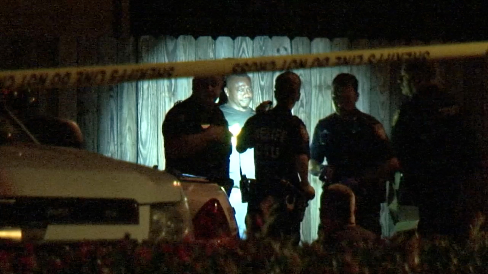 In this image made from a video, police arrest a man after he surrendered Sunday in Houston.