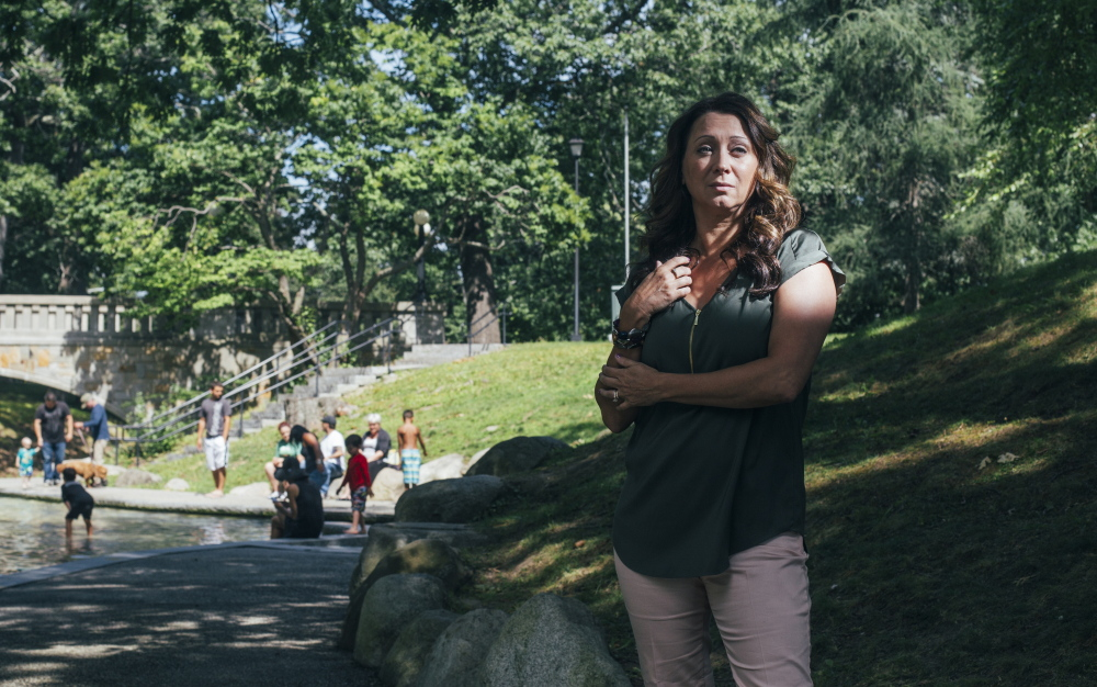 Laurie Bachelder stands near the wading pool in Deering Oaks, where a drug user collapsed near her family two weeks ago. Changed by the experience, she is volunteering to help with the drug problem, a response welcomed by the drug recovery community.
