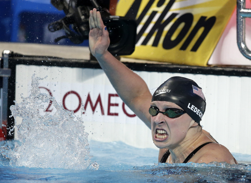 United States' Katie Ledecky celebrates after winning the women's 800m freestyle final at the Swimming World Championships in Kazan, Russia, Saturday, Aug. 8, 2015. (AP Photo/Michael Sohn)