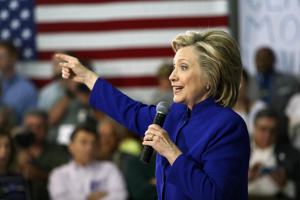 "Hillary Clinton, seen speaking during a campaign stop Tuesday at River Valley Community College in Claremont, N.H., has ""pledged to cooperate with the government's security inquiry"" into her private email account, according to her campaign spokesman."