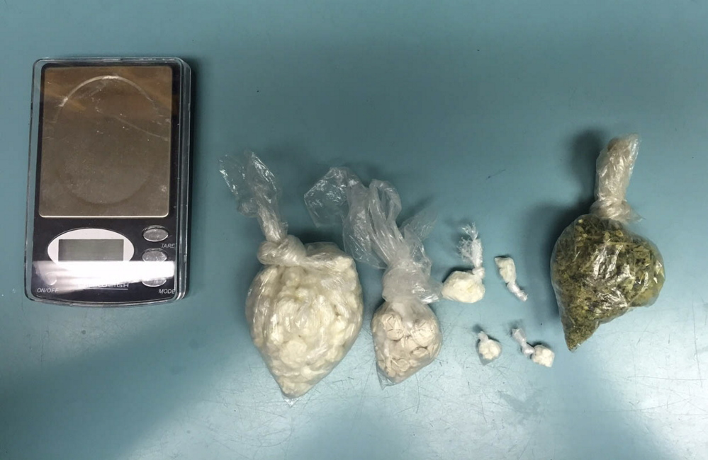 Some of the items and drugs seized by Scarborough police and federal Drug Enforcement Administration agents Tuesday.
