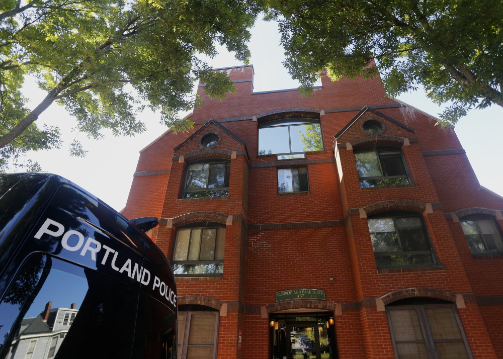 Freddie Akoa, 49, was found dead in his apartment at 457 Cumberland Ave. in Portland, and police have charged three men with murdering him.