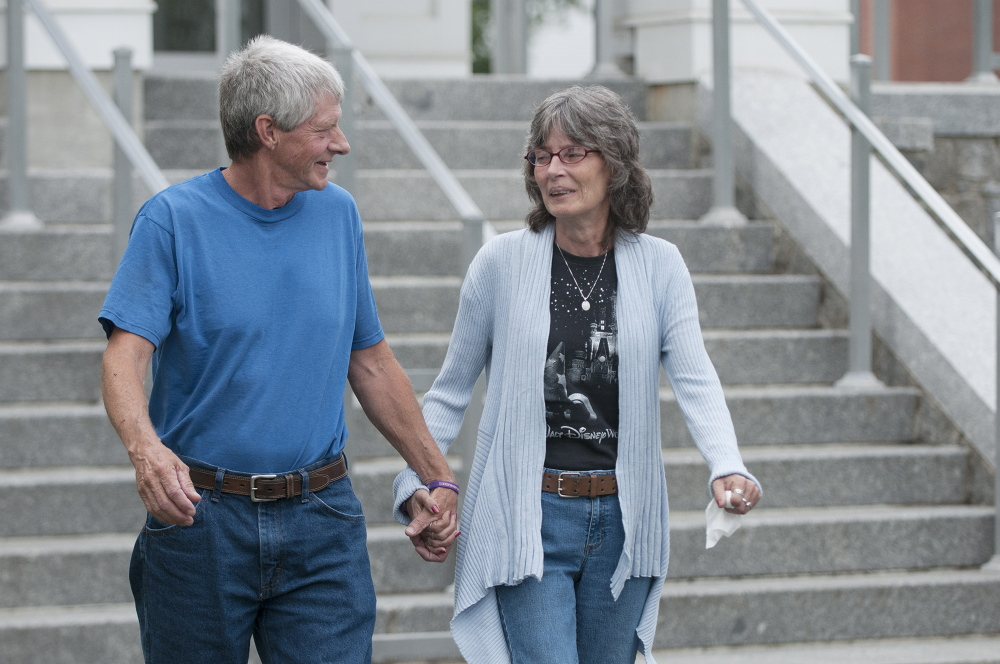 Vance Ginn, left, and his wife, Angel Ginn, leave Piscataquis County Superior Court on Wednesday after attending Robert Burton's initial appearance in connection with the slaying of their daughter, Stephanie Gebo, in Parkman in June.