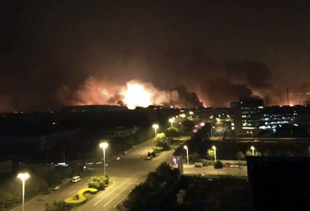 Smoke and fire erupt into the night sky after an explosion in north China's Tianjin municipality Thursday. At least seven people died and hundreds of injured are being treated at nearby hospitals, officials reported.
