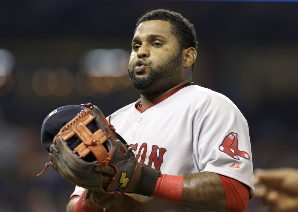 Red Sox third baseman Pablo Sandoval heads to the dugout at the end of the seventh the inning Wednesday in Miami, with his team on its way to a 14-6 loss.