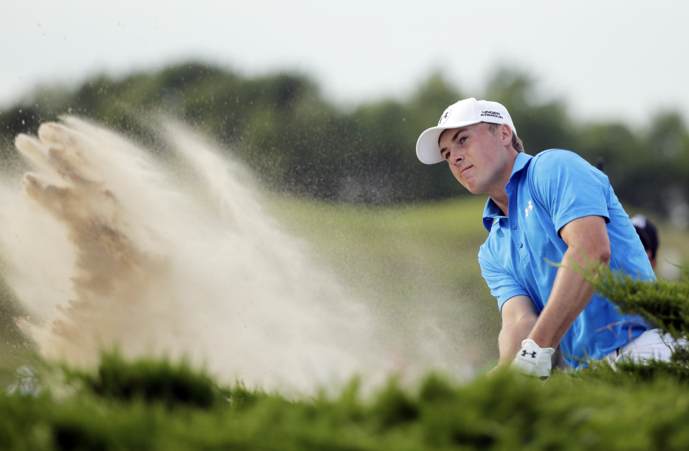 Jordan Spieth hits out of a bunker on the 15th hole at Whistling Straits. The Masters and U.S. Open champion finished with a 71, five shots off the lead.