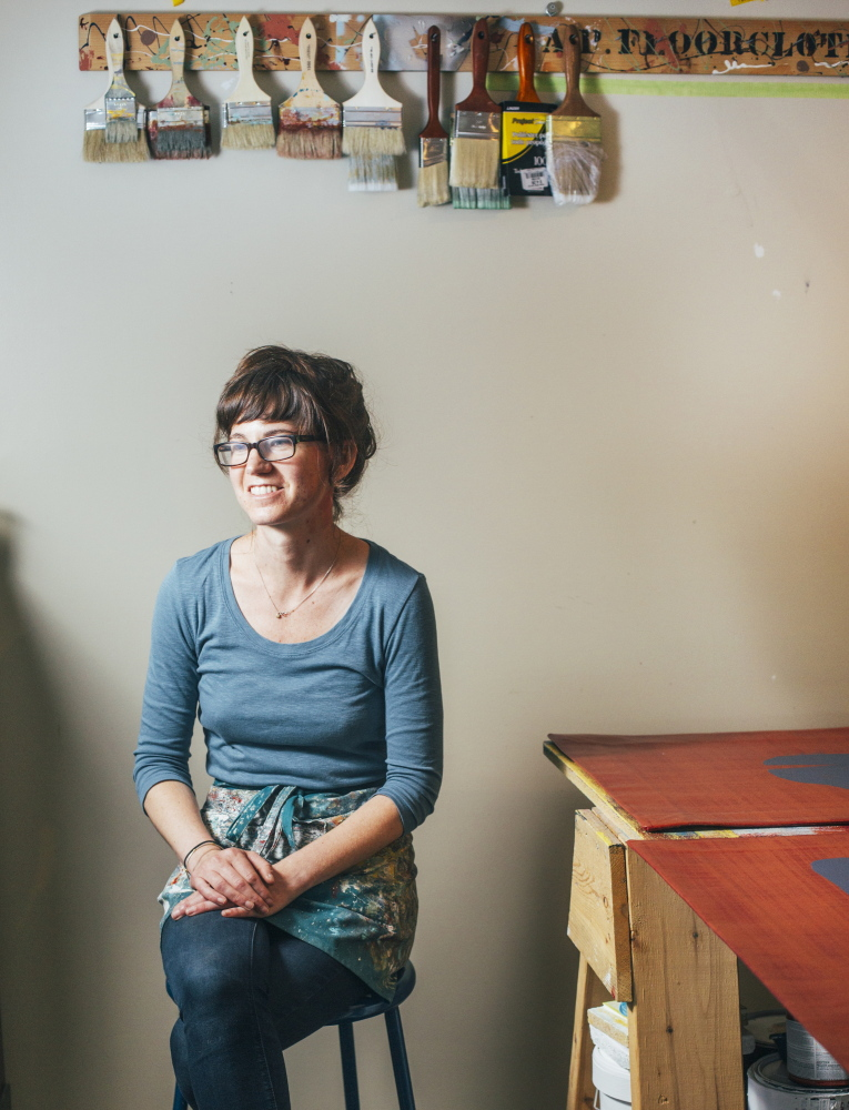 Floorcloth maker Addie Peet in her studio in Winterport.