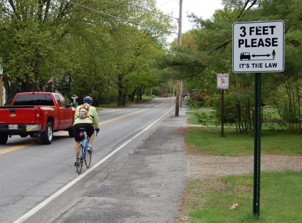 Signs in Brunswick notify motorists to give at least 3 feet of clearance when passing bicyclists. Courtesy photo