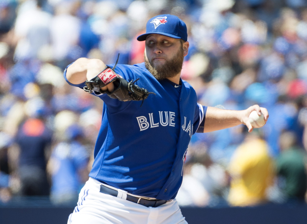 Toronto's Mark Buehrle worked into the eighth inning Thursday during the Blue Jays' 4-2 home victory over Oakland that pushed their winning streak to 11 games.