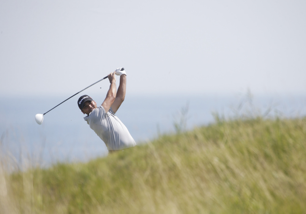 Jason Day hits on the fifth hole during the second round of the PGA Championship on Friday at Whistling Straits. Day was tied for the lead with Matt Jones when play was suspended.