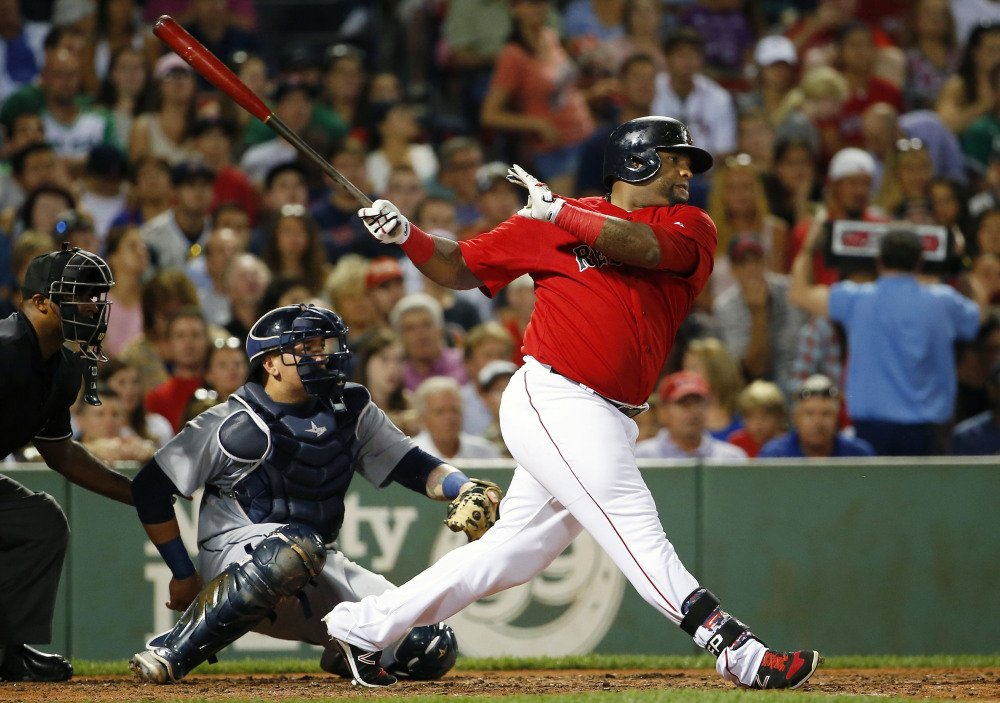 Boston's Pablo Sandoval follows through on a two-run double in the third inning, when the Red Sox scored six runs and put the game away.