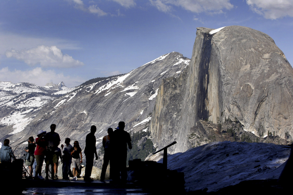 Officials say an oak tree limb fell on a tent in the heart of Yosemite National Park, killing two young campers early Friday morning.