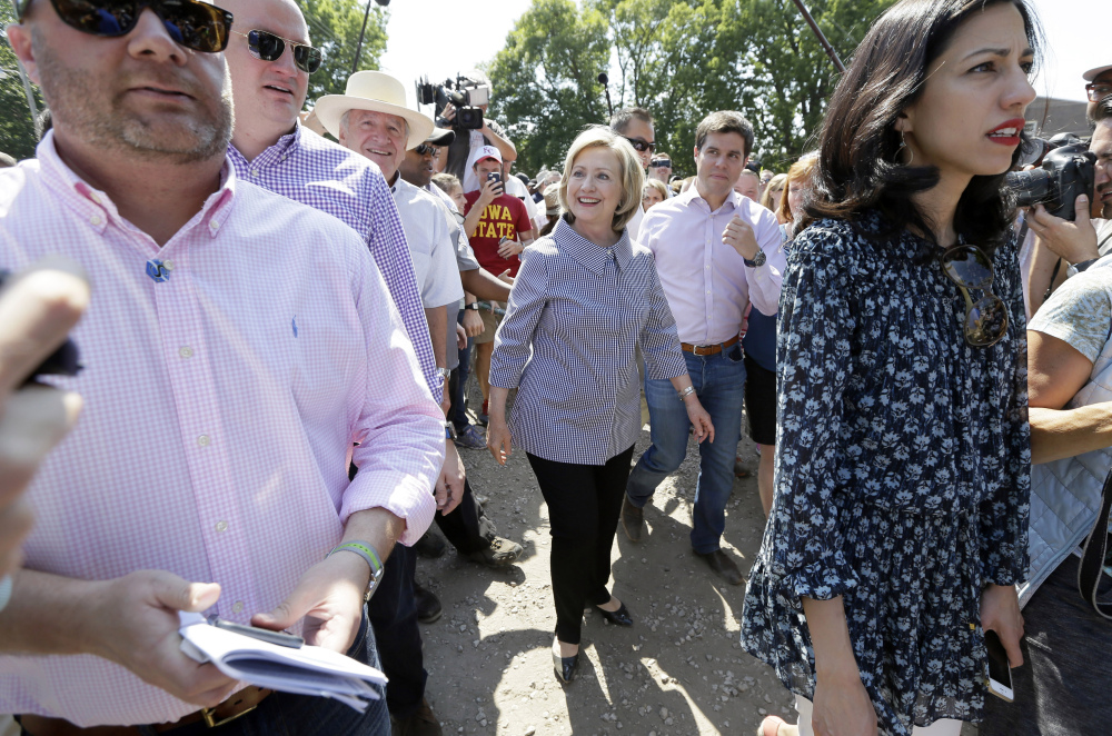 Democratic presidential candidate Hillary Rodham Clinton walks down the concourse during a visit to the Iowa State Fair on Saturday. The Associated Press