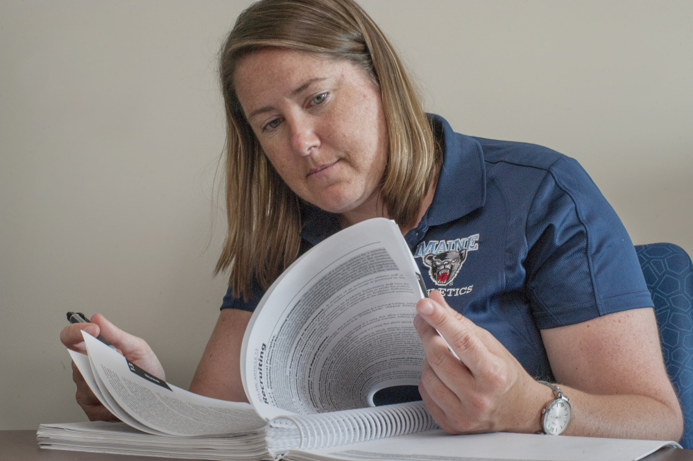 """The NCAA rules governing recruitment are so complex that universities all employ one or more """"compliance officers."""" At UMaine, that's Eileen Flaherty, pictured here at her office at the Memorial Gym in Orono."""