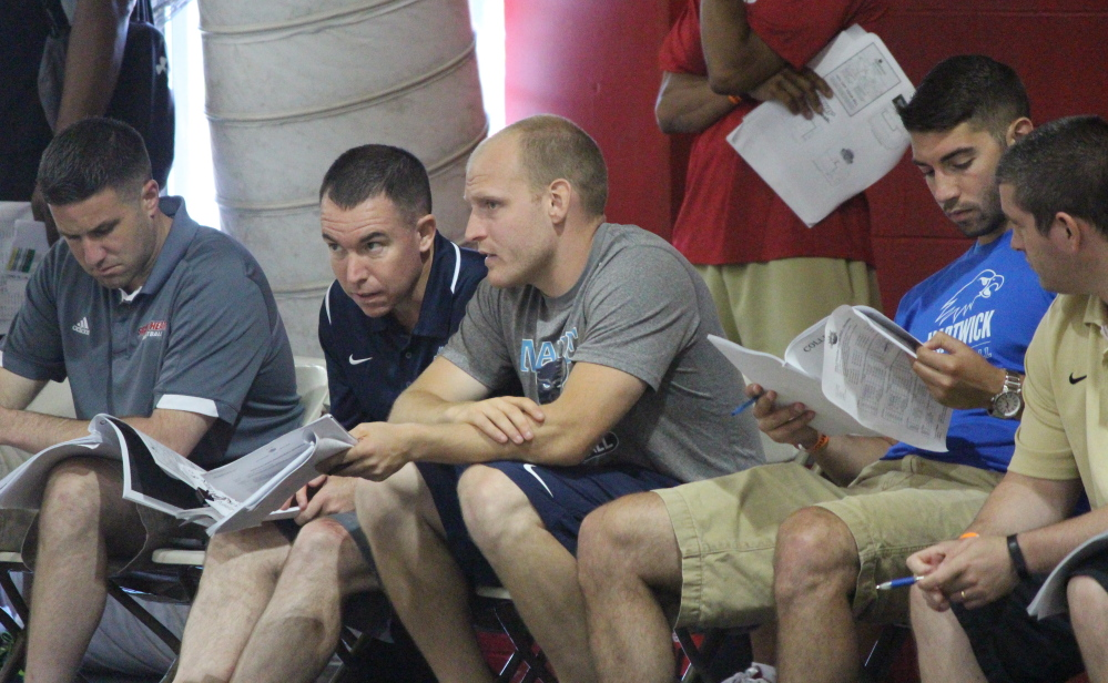 Bob Walsh, second from left, head coach of the men's basketball team at the University of Maine, works with one of his assistant coaches, Zak Boisvert, scouting young athletes at last month's Hoop Group Elite Camp in Reading, Pa.