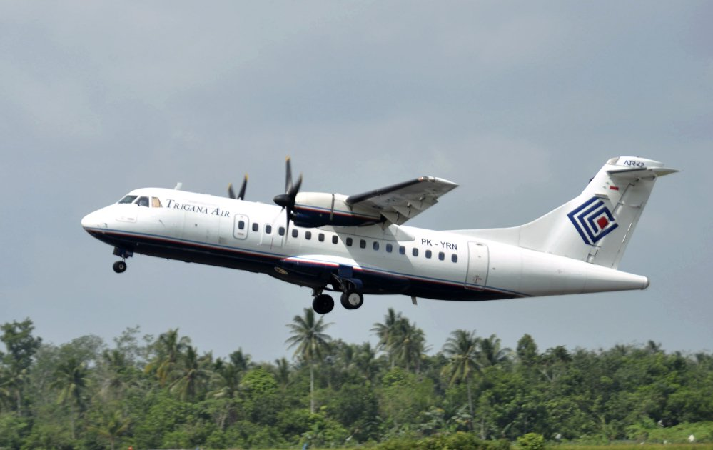 A Trigana Air Service ATR42-300 twin turboprop plane takes off at Supadio airport in Pontianak, West Kalimantan, Indonesia, in 2010.