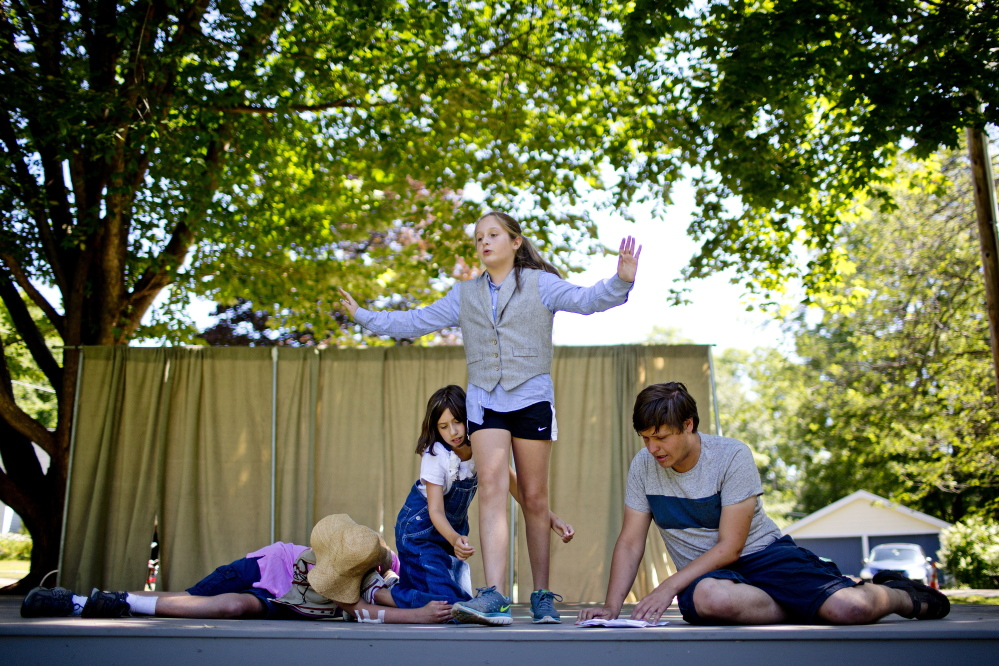 From left, Ian Pizey, 14, of Kennebunk, Sophie Weil, Maeve Sheehan, 11, of Kennebunk, and Kyle Walton, a staff member with MaineStage Shakespeare, rehearse a scene in Lafayette Park in Kennebunk on Friday.