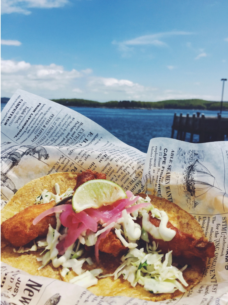 A fish taco and lobster roll. The lobster rolls are offered three ways.