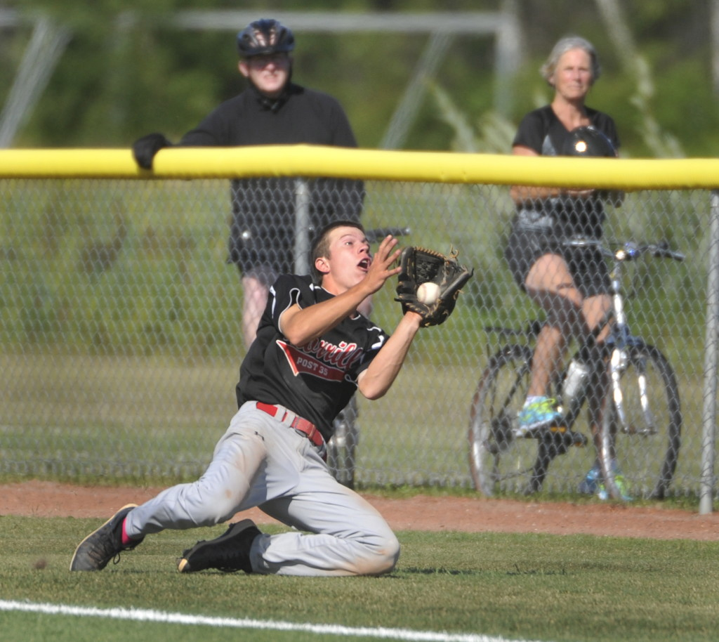 Morrill Post right fielder Jacob Brown makes a sliding catch of a foul ball in the fifth inning against Coffee News. Morrill won three straight elimination games to reach the final but couldn't dethrone the defending champions. John Ewing/Staff Photographer