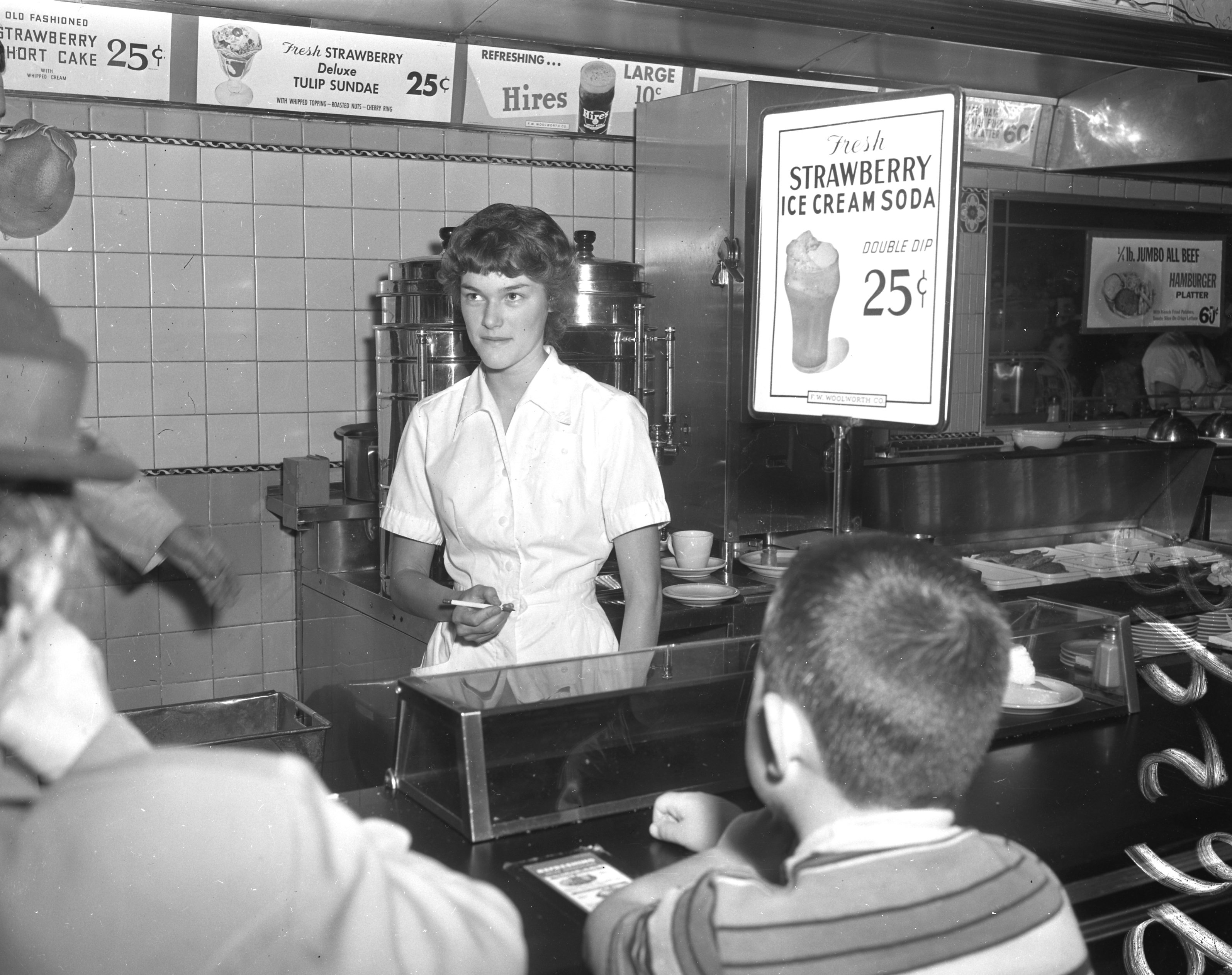 Flashback: a September 1960 Press Herald photograph of a waitress taking an order at the F. W. Woolworth lunch counter on Congress Street.