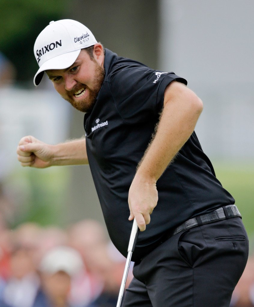 Shane Lowry, from Ireland, pumps his fist as he watches his birdie putt on the 18th hole to win the Bridgestone Invitational golf tournament at Firestone Country Club, Sunday in Akron, Ohio. The Associated Press