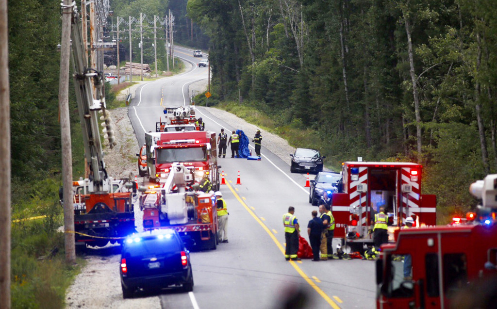 First responders reconstruct the scene of the Aug. 11 crash on Route 11 in Casco that killed a 4-year-old Cameron Joseph Petersen and critically injured his mother, Crystal Petersen, 26, of Gray.  Gabe Souza/Staff Photographer
