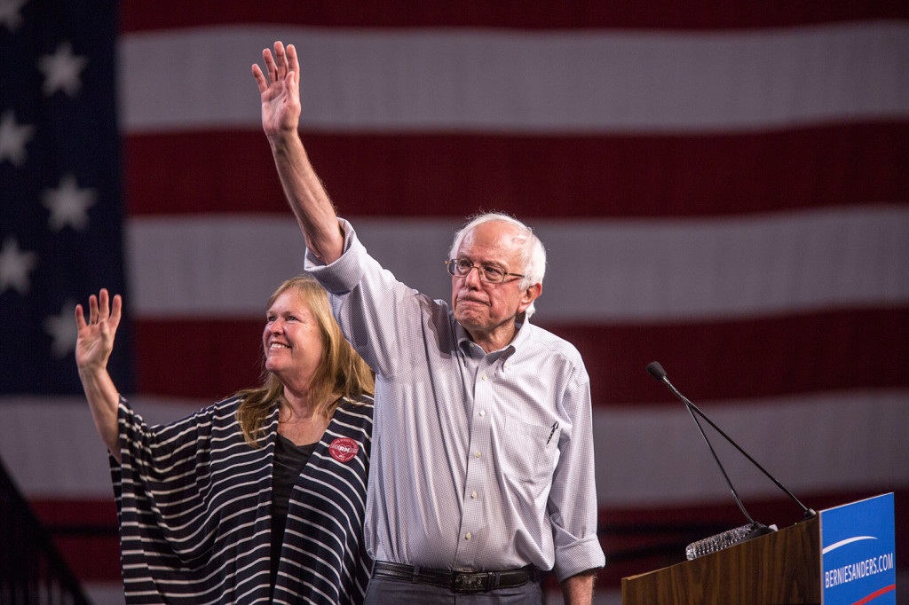 Democratic presidential candidate Sen. Bernie Sanders, with his wife Jane, waves at a rally at the Los Angeles Memorial Sports Arena.