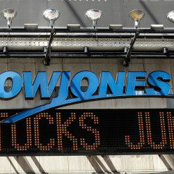 The Dow Jones ticker in Times square announces a stock rebound Tuesday in New York. U.S. stocks jumped at the open after China's central bank cut interest rates to support its economy.